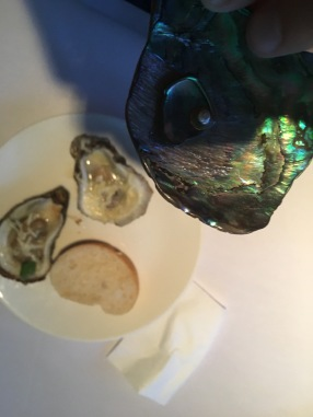 Grilled oysters and a New Zealand paua shell.