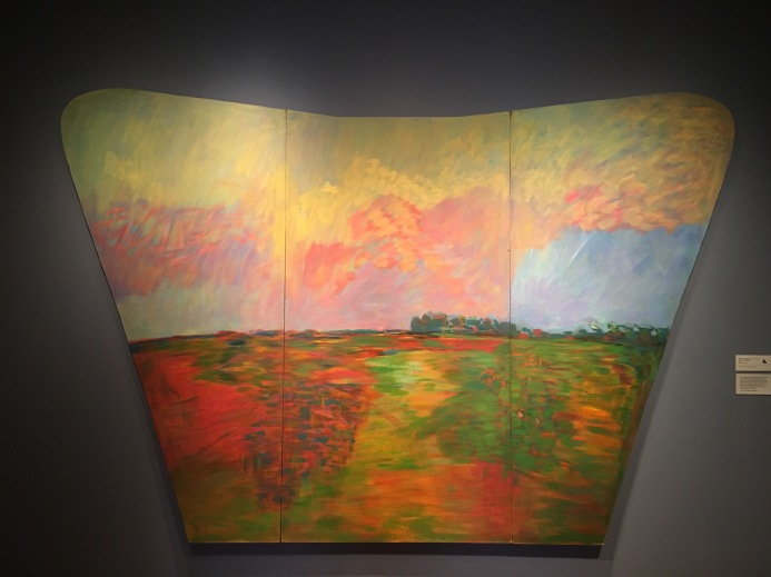 "Elmore Morgan Jr. (1931-2008), View from the Prairie. 1988. Acrylic on Masonite. ""This might sound kind of cosmic or mystic, but one of the things that excites me about the prairie is that it's eighty percent sky and twenty percent land. Much of what you see is sky, it's a great dome. When you paint out here, you can feel the Earth falling off to either side . . . I swear, in my own little backyard I can almost feel the shape of the planet."""